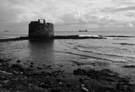 Old defensive tower of San Cristobal, bay of Las Palmas, Canary Islands, black and white mode Editorial