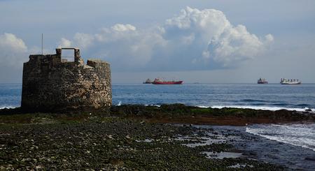 Old defensive tower by the sea, San Cristobal, coast of Las Palmas de Gran Canaria