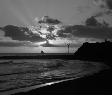 Awesome sunrise from the beach with marine windmill in the background, La Laja, coast of Las Palmas de Gran Canaria