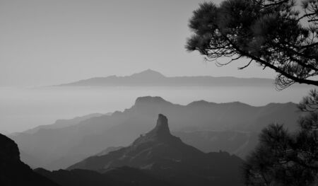 Mountain landscape and Roque Bentayga, from the summit of Gran Canaria, black and white, Canary Islands Фото со стока
