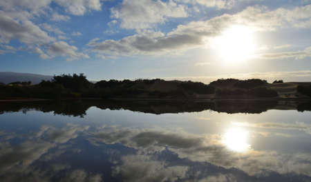 Awesome sunrise with beautiful reflections in the water, Charca de Maspalomas, Canary Islands, Spain