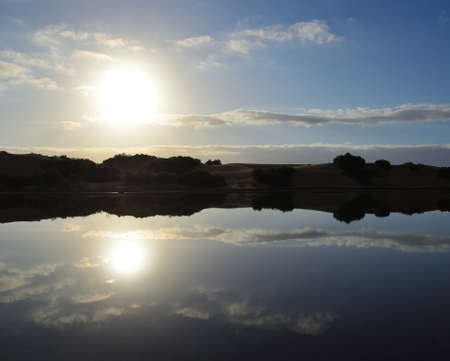 Awesome sunrise with reflections on the lagoon, Maspalomas, south of Gran Canaria, Canary Islands