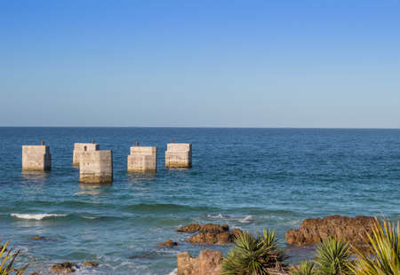 old pier: Photo of old pier at Humewood beach Port Elizabeth South Africa Stock Photo