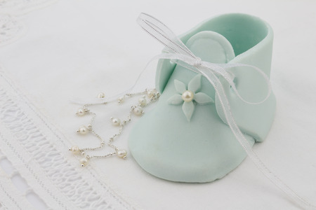 booty: Baby pale blue fondant booty isolated on white background Stock Photo