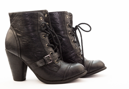warm things: Pair of black female  leather boots over white background