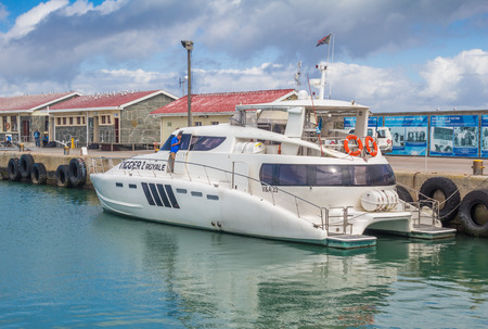 ROBBEN ISLAND, SOUTH AFRICA - DECEMBER 19, 2016: Photo of luxury 55 foot power cat berthed at dock at Robben Island where Nelson Mandela, later President of South Africa was in prison for 18 years Editorial
