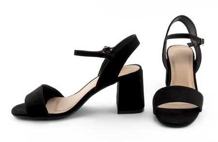 Studio photo of a pair of black suede female sandals on white background