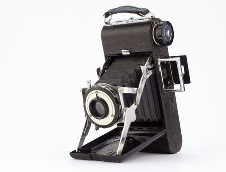 Antique well used rusty old photographic camera isolated on white background Foto de archivo