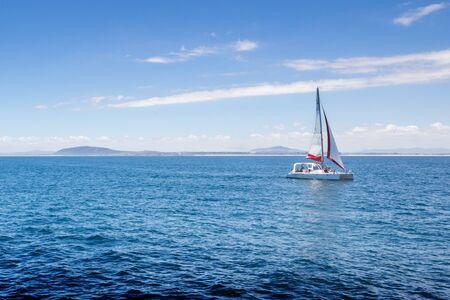 robben island: View of sailing boat on Atlantic Ocean near Robben Island, South African coast Stock Photo