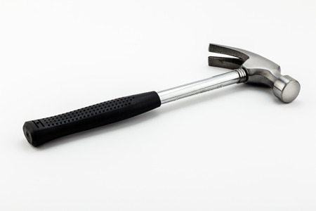 Iron hammer with black rubber grip isolated on white background