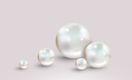 Pearl background with five different size beautiful shining white pearls isolated on grey pink surface Stock Photo