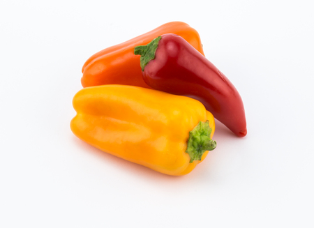 Three sweet orange, red and yelllow peppers on white background