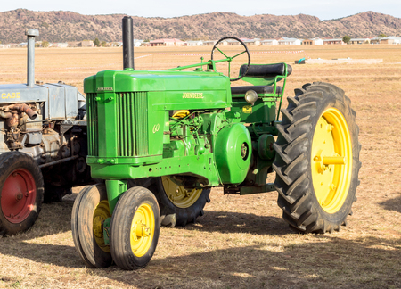 Queenstown, South Africa, 17 June 2017: Vintage John Deere tractor on display at Queenstown Air Show - Illustrative editorial image