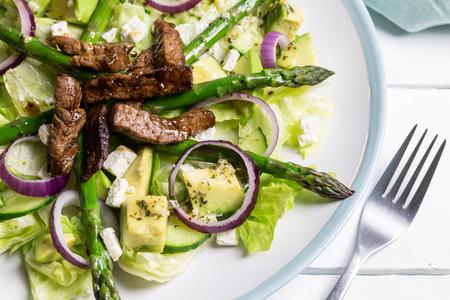 Steak avocado and asparagus salad