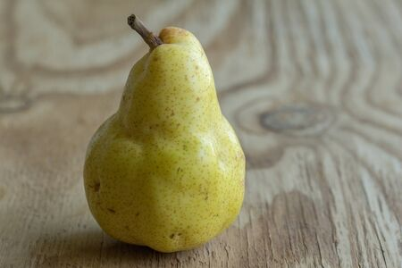 Pear on rustic wooden table - Image of Bartlett pear