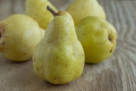 Pears on rustic wood background - Horizontal image of Bartlett pears
