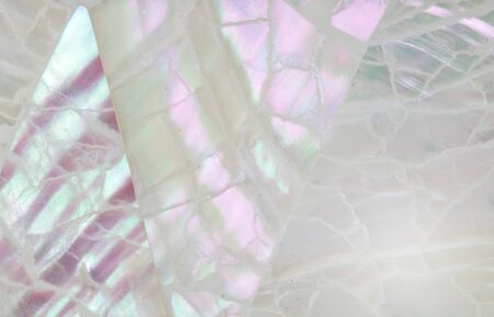 Abstract mother of pearl background with lilac, mauve and aqua shimmering mosaic inlay - top blurred view
