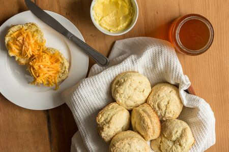 Scones, cheese and butter - Top view photo