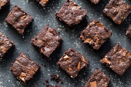 Chocolate brownies on mottled grey and white background - top view Stock fotó