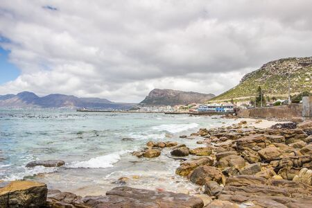 CAPE TOWN , SOUTH AFRICA - 03 JANUARY 2019: View from St James beach over Kalk Bay harbour in |False Bay, Cape Town South Africa