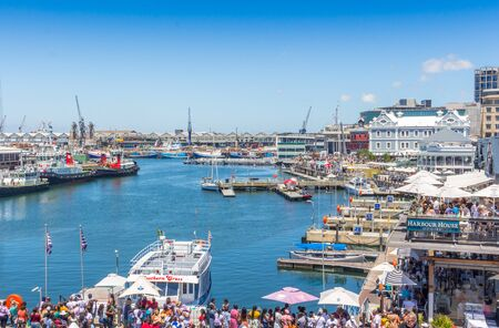 CAPE TOWN , SOUTH AFRICA - 01 JANUARY 2020: V & A Waterfront with many tourists celebrating a summer New Years day at the Cape Town harbour