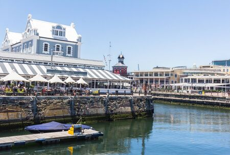 CAPE TOWN , SOUTH AFRICA - 01 JANUARY 2020: Side view of the Old Port Captain's building built in 1904 in the style of the Arts and Crafts movement at the V & A Waterfront Cape Town a popular tourist attraction on New Years Day 2020