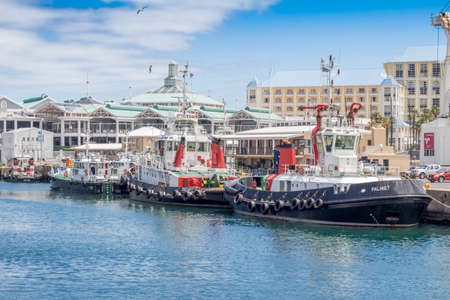 CAPE TOWN, SOUTH AFRICA - DECEMBER 19 2016: Tugboats anchored in Victoria and Alfred Waterfront harbour in Cape Town, Western Cape South Africa