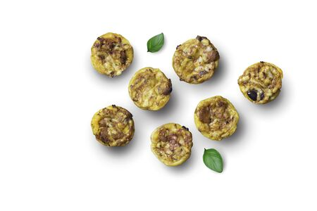 Mini savory pies with cheese, olives, herbs and bits of chorizo sausage - little appetizer tartlets isolated on white background