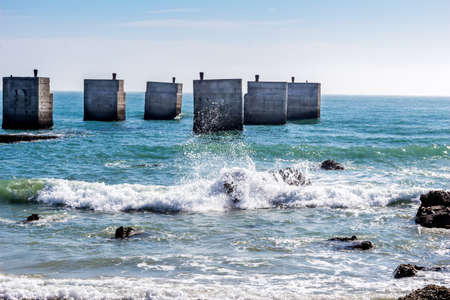 Old pier at Humewood Beach in Port Elizabeth, South Africa - Waves and ocean at beach