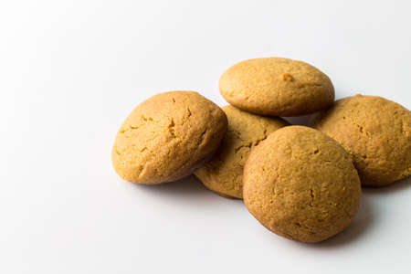 Gingerbread round cookies in a heap isolated on white background with copy space - gingersnap biscuits background