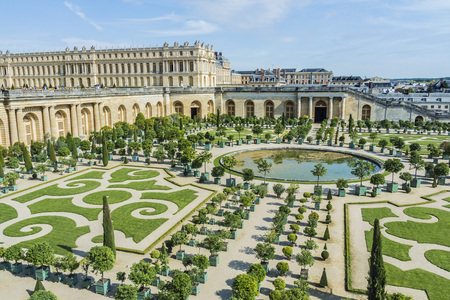 Tourists strolling the Chateau de Versailles Gardens in Paris, France.