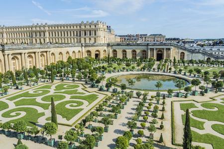 Tourists strolling the Chateau de Versailles Gardens in Paris, France.