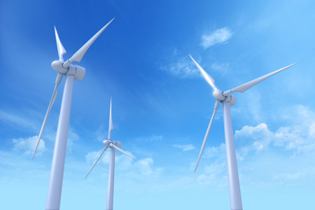 Wind Turbines against a blue sky with light clouds.