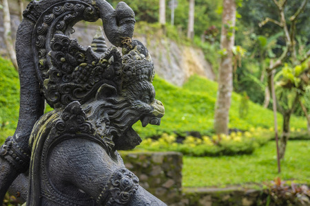 Stone statue inside the Gunung Kawi Sebatu Temple, Ubud, Bali, Indonesia. The temple complex is located within the highland village of Sebatu in Tegallalang, Gianyar, approximately 12km northeast from the main Ubud hub.