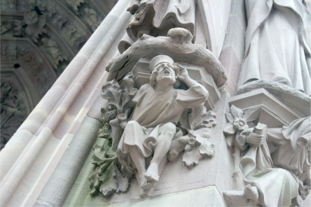 allegory: Allegory of hearing on the main portal of the Protestant Church of St. Peter Young (1320). Strasbourg, France Stock Photo