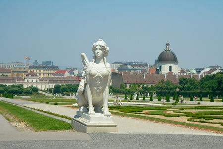 Sphinx in Belvedere garden, Vienna, Austria  Behind the houses could be seen Church of the Order of the Visitation of Holy Mary photo