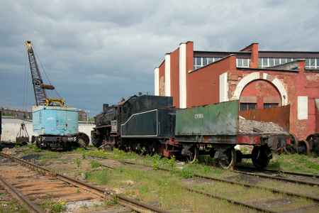 Moscow, Russia - May 17 2014  TE-3162 steam locomotive with open wagon and crane at depot on old railway station Podmoskovnaya