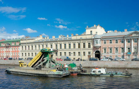 river       water: Saint Petersburg, Russia - July 21 2014: Cleaning the bottom of Fontanka river using dredger.