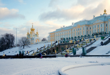 bartolomeo rastrelli: Peterhof Grand Palace (1715-1755), Palace Church ((1745 by Francesco Bartolomeo Rastrelli) and Grand Cascade (1721-1721) in winter in sunset, Russia