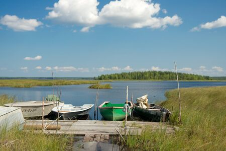 footway: Karelia region, Russia - July 27 2014: Boats moored to a wooden planked footway on Lindozero Lake. Editorial