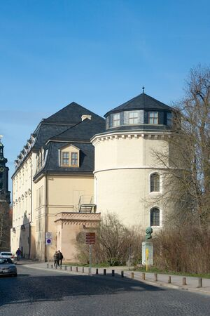 passerby: Weimar, Germany - April 7 2015: Duchess Anna Amalia Library 1691 by Nikolaus Gromann and passers-by on Belvederer Allee.