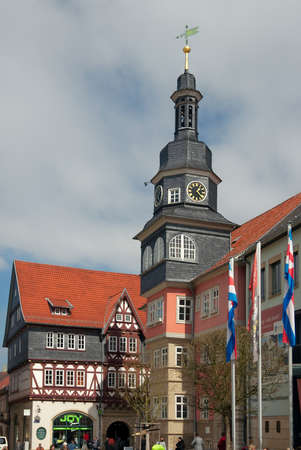 passerby: Eisenach, Germany - April 8 2015: Town hall 1641 and passers-by. Editorial