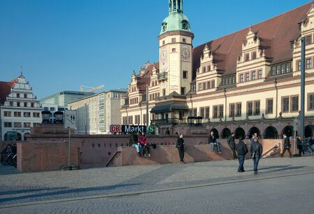 passerby: Leipzig, Germany - April 9 2015: People next to entrance to the Markt underground s-bahn station.