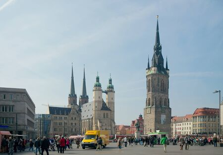passerby: Halle, Germany - April 9 2015: Market Square, Market Church of St. Mary Marktkirche, 15291554 and Red Tower Roter Turm, between 1418 and 1503 and passers-by.