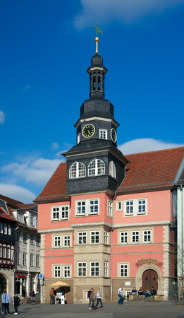 passerby: Eisenach, Germany - April 8 2015: Town hall 1641 and passers-by on the square.