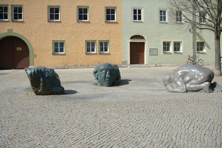 swallowing: Weimar, Germany - April 7 2015: Fountain Spucken und Schlucken spitting and swallowing, 2007 by Walter Sachs, turned off.