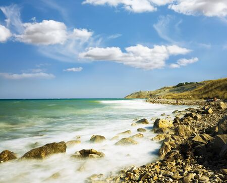 accrue: Sea Sky stones Wave winding coastline accrue at  Stock Photo