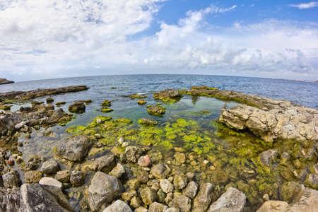 accrue: Sea Sky stones Wave winding coastline accrue at  Stock Photo