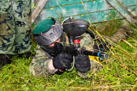 paintball: Paintball players in full gear at the shooting range