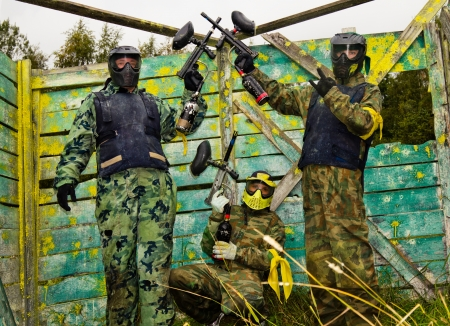 Paintball players in full gear at the shooting range